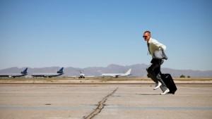 man running at airport